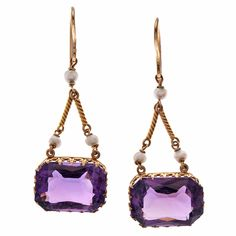 """Classic Victorian Amethyst and Natural Pearl Drop Earrings. Circa 1890.    Unique architectural style, with a golden chain forming a triangle over rectangular amethyst stones which sit """"east to West"""". The mountings for the major stones are highly detailed and in excellent condition."""