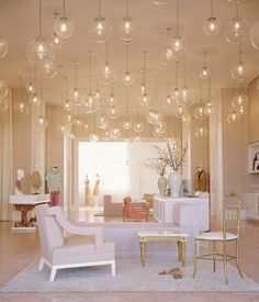 Kelly Wearstler interior design for Trina Turk store. Globe pendant heaven.