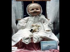 """Mandy the Haunted Doll lives at the Quesnel Museum, which is located on the Old Cariboo Gold Rush Trail in British Columbia. There she is just one of over thirty thousand artifacts on display for the public, but there is little doubt that she is the most unique. Mandy was donated to the museum in 1991. At that time her clothing was dirty, her body was ripped and her head was full of cracks. At that time she was estimated to be over ninety years old. The saying around the museum is, """"She may"""