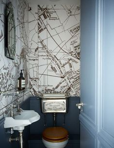 Modern Cloakroom Ideas: Cloakrooms & Powder Rooms Decor Inspiration They may be the smallest rooms in the house but they're perfect for experimenting with bold style & wallpaper. Get inspired by these modern cloakroom ideas Small Toilet Room, Guest Toilet, Clockroom Toilet, Toilet Room Decor, Cloakroom Toilet Downstairs Loo, Small Wc Ideas Downstairs Loo, Wallpaper Toilet, Cloakroom Wallpaper, Map Wallpaper