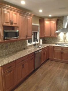 Cinnamon Maple Cabinets Grand Luxe Mosaic Tile Giallo Ornamental Granite with Half-Bullnose Edge Detail