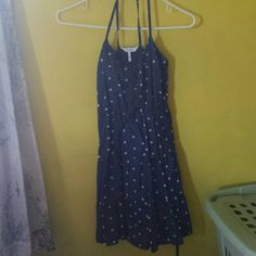 Blue with White Polka Dots Dress Blue dress with white polka dots all over the dress. On the top half there are buttons down the middle. The straps cross in the back. Im sure it would be comfy if it fit the right person. Never really worn because its too small for me so its in great condition!  No trades but willing to negotiate!! Kirra Dresses