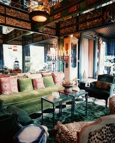 Living Room Eclectic Photo - A green couch arranged with green and leopard-print upholstered chairs