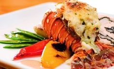 Groupon - Food and Drinks at Wray's Caribbean and Seafood (Up to 46% Off). Four Options Available. in Clinton Hill. Groupon deal price: $22