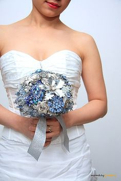 Wedding brooch bouquet DAZZLING BLUE II -  bridal bouquet made with vintage brooches, earrings and more - blue and silver, via Etsy.