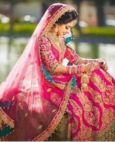 This bride looks so elegant in her pink bridal lehenga! We love the added detail of the contrast color for a great pop of color! Indian Bridal Wear, Pakistani Bridal, Bride Indian, Indian Weddings, Hindu Weddings, Bollywood, Hindu Girl, Indian Dresses, Indian Outfits