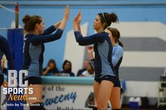 SeLady Bucs Kirby Kincannon and Alexa Lezak give each other high fives during their game against Sweeny.