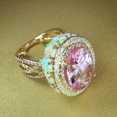 Lovely pink topaz and opal ring by @ericacourtneyjewels