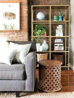 ikea shelving - painted gold for living room.  A Grown-Up Brownstone in Brooklyn Heights | Design*Sponge