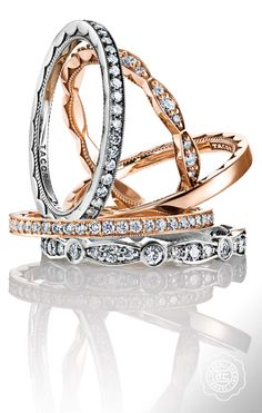 Sweet and sophisticated. Love the idea of stacking rose gold and platinum wedding bands.
