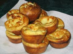 Yorkshire Pudding ~ equal parts flour, egg, milk; pour into greased hot tins; bake; serve with savory gravy; enjoy