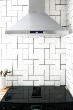 How to install a kitchen backsplash wall of subway tiles laid in a straight herringbone pattern
