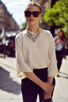 Love. Unique cut on the blouse, statement necklace, stacked gold rings. Polished.