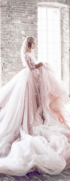 We're swooning over this flowing, extra-long and extra blushing bit of bridal beauty.