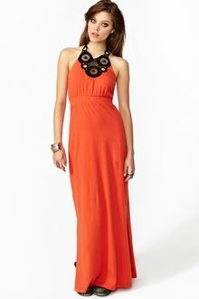 """Bright orange maxi dress featuring a black crochet halter neckline. Side slits, open back. Stretch panel at waist, unlined. Looks awesome paired with stacked rings and platform boots!    *Cotton/Spandex Blend  *14.5"""" bust  *11.75"""" waist  *Approx. 60"""" length  *Model is wearing size small *Runs true to size *Hand wash cold *Imported  Gorgeous huh? Place an order http://obaoja.com/clothing-shoes-and-accessories/nasty-gal-wicked-crochet-maxi-dress-5541.html"""