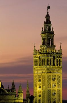 Spain - Sevilla's most beautiful building, the Moorish Giralda, was built from 1184-96, but later on suffered many additions; illuminated at dusk.