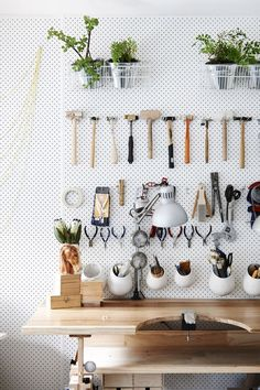 Homeowners have been using pegboards to organize their tools since the dawn of the pegboard, but Kim Victoria Wearne and Stuart Beer upgraded the standard setup with this elegant, minimalist organizational system, as seen at The Design Files.   - ELLEDecor.com