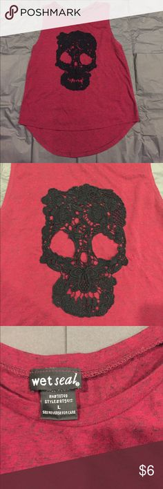 Wet seal lace skull tank Wet seal size large lace skull hi-lo tank. Mild pulling under the arms, but Excellent used condition. Black/red marble blend Wet Seal Tops Muscle Tees