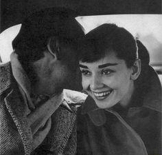 171--Audrey and Mel Ferrer share a secret in Paris, 1956.