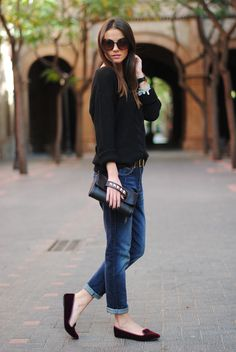 black sweater, boyfriend jeans, black clutch, burgundy smoking flats