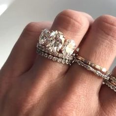 """My diamonds just sparkle too much!""…. Said no girl ever. Featured: Dainty Baguette stacker in 14k rose gold + Good Stone alternating stackable wedding band in 18k white gold + a 6.00ctw 3 stone oval engagement ring in 18k rose gold. Custom, unique wedding sets and ladies wedding bands available on the site! (More custom pieces depicted not listed)"
