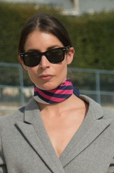Yes, the French remind us daily that there are a million ways to style a scarf, but among our favorites is wearing it tied delicately around the neck. It's easy enough to tie, elongates the neck, and is totally retro-cool.   - MarieClaire.com