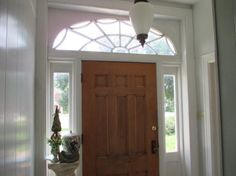 1504 W Main St, Jefferson City, MO 65109 - Home For Sale and Real Estate Listing - realtor.com® Entryway Transom, big door, and sidelites with a beautiful light fixture.