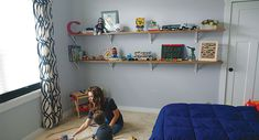 Toys, books and everyday kid essentials pile up quick. We took on the kid chaos by creating fun, open DIY shelves for our son's toddler room. Ikea Ekby, Kid Essentials, Toddler Rooms, Room Shelves, Shelf Brackets, Clutter, Playroom, Bookcase, Real Estate