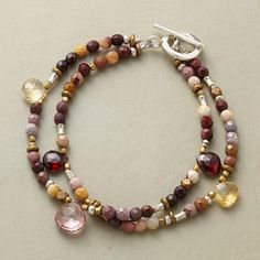 Two strands of jasper, accented with brass and sterling beads and drops of garnet, citrine and pink topaz, arrive at a sterling silver toggle.