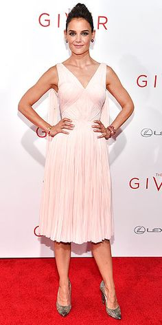 Also at the N.Y.C. premiere of The Giver, Katie goes with a ladylike ballet-pink Zac Posen design featuring a fitted, intricately pleated bodice.