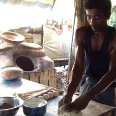 Making naan for breakfast at New City Tea Centre, Pathein Myanmar