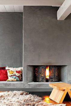 Concrete fireplace design via Marie Claire Maison Concrete Fireplace, Fireplace Hearth, Home Fireplace, Modern Fireplace, Fireplace Design, Fireplaces, Fireplace Seating, Grey Fireplace, Minimalist Interior