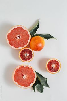 Fresh cut citrus by Michelle Moore for Stocksy UnitedYou can find Blood orange and more on our website.Fresh cut citrus by Michelle Moore for Stocksy United Fruit Art, Fresh Fruit, Fruit Trees, Orange Aesthetic, Summer Aesthetic, Fruit Photography, Still Life Photography, Fred Instagram, Minimalist Photography