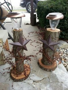 Old logs and solar lights and barn stars and berry garland