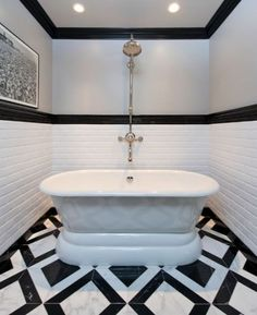 Monochromatic chic bath | Jeff Lewis Design.  bold black and white striped floor in the bathroom.  home decor and interior decorating inspiration.