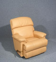 This is a wonderful tan leather lazy boy Cardinal manual recliner chair   Designed for comfort with adjustable footrest and lumber support  Wooden handle to the side which releases the recline and footrest mechanism  Delivers superior support and unprecedented comfort  Beautiful butter soft leather  Measures approx    105 cms High    95 cms Wide    90 cms Deep   Seat Height  50 cms