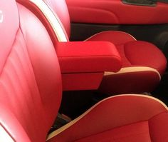 Armrest in automotive red eco leather with storage covered in the same material