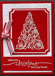 handmade Christmas card ... red and white ... Swirled Christmas tree white embossed on red with double matting ... great greeting .. candy cane striped ribbon ... great card!! ... Stampin' Up!