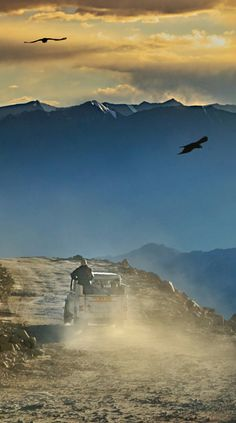 Driving down a dusty road in Ladakh, India from Pangong Lake to Leh and admiring the sunset...