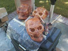 Decaying skull Halloween prop, using plastic skull and plastic wrap