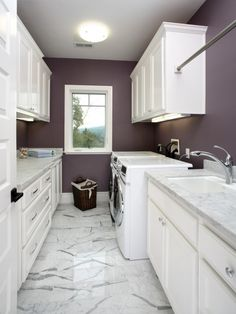 Love the Paint Color, Under Cabinet Lighting, all the folding room, Clothes Hanging Bar & Marble!