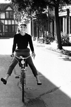 Audrey Hepburn, wearing a variation of her iconic style of cropped pants and ballet flats, c.1950s