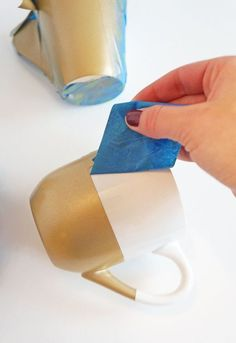 These DIY gold geometric mugs  are a great way to upcycle plain mugs into something beautiful with paint and tape.
