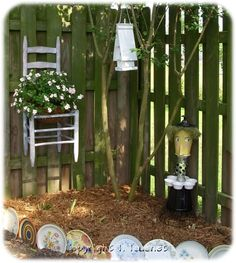 Love the idea of a small corner in the yard. Cute fence!