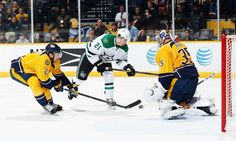 Rinne in the way:    Pekka Rinne #35 of the Nashville Predators makes the save against Antoine Roussel #21 of the Dallas Stars on Mar. 1 in Nashville, Tennessee.   -       © John Russell/NHLI/Getty Images