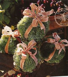 How clever! Decorate your home with Christmas ornaments made from greenery and ribbon! These ornaments seem to be made from artificial greenery and a florist ball. I would think you could achieve a wonderful effect by using real greenery such as boxwood or mistletoe, although you would probably need a smaller florist ball. Remember to remove the berries from Mistletoe, as they are poisonous.