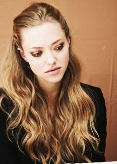Amanda Seyfried - very dark blonde pretty much a light brown hair color,wavy