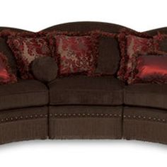 Curving sectional sofa with a scalloped back and oversized nailhead trim. Product: Sectional sofaConstruction Mater...