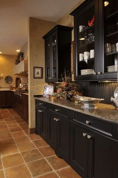 the black kitchen cabinets i like the beadboard backsplash....we have plenty of that!!!!