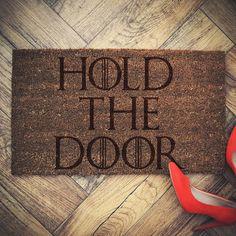 """Game of Thrones inspired doormat coconut """" HOLD THE DOOR """" door mat by EngravedLaboratory on Etsy https://www.etsy.com/listing/459236748/game-of-thrones-inspired-doormat-coconut"""